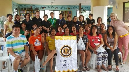 The Makati ladies with DC Christine takes a photo op with Bhoy Navarette and the 27 recipients of our hairstyling kit composed of parlor shear, hair clips, spray gun,barber's cape and tail comb.