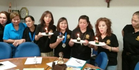 the  September birthday celebrants  blowing  their birthday candles…